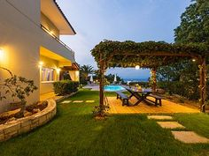 Rethymno villa rental - Try al fresco dining under the flower covered pergola!