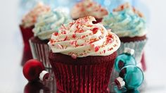 Creamy frosting doubles as a surprise filling in rich, red velvet cupcakes.