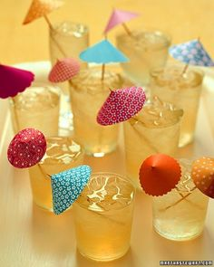 What's a tropical cocktail without an umbrella? Improve on the store-bought variety by making your own elegant little parasols out of origami paper and wooden skewers.