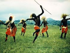 Tutsi men celebrate their heritage with a joyous ritual dance.    Photograph by George F. Mobley