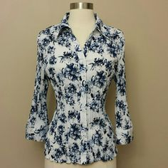 "Blue and white floral blouse 3/4 length sleeves White stretch blouse with a blue floral pattern.  Three quarter length sleeves.  24"" length, 17.5"" sleeves from shoulder, 15"" flat front waist. Christopher & Banks Tops Blouses"