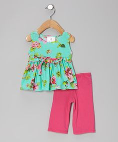 This blooming tunic and pants are great for a day spent outside. The tunic is made of soft and thick cotton, while the pants have a snug elastic waistband, keeping little ones happy from sun up 'til sun down.Size Note: Infant sizes run small. Mad Sky recommends ordering one size up.Includes tunic and pants...
