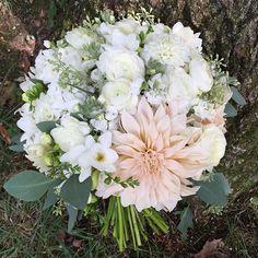 A summertime bridal bouquet of dahlias, ranunculus, freesia and seeded eucalyptus. Designed by www.silvertoad.com #vermontweddingflowers #VT #bouquet #bride #SilverToadVT