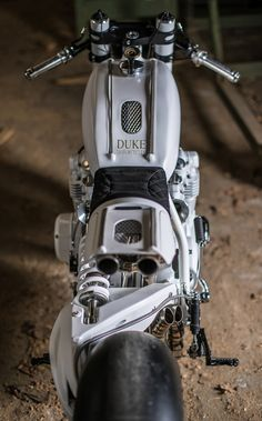 Lionel Duke owns and operates Duke Motorcycles a workshop located at Tourrettes Sur Loup France. With this Honda project Lionel set out to build a custom bike deliberately different from what we see. Well he has certainly achieved that. Duke Motorcycle, Duke Bike, Motorcycle Design, Motorcycle Style, Bike Design, Custom Motorcycles, Custom Bikes, Cars And Motorcycles, Honda