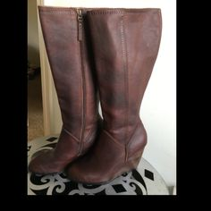 """Winter clearance!! Fossil leather boots Fossil leather boots. Never worn. Some """"rub off"""" on outside of boot. Believe it came from resting up against another pair of boots I have in closet. Can be covered with shoe polish. Fossil Shoes Heeled Boots"""