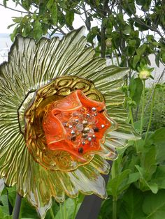 Whimsy in the garden.old plastic christmas ornaments on a small painted dowel .what an easy idea :) garden yard art. Glass Garden Flowers, Glass Plate Flowers, Glass Garden Art, Flower Plates, Glass Art, Garden Crafts, Garden Projects, Landscape Design, Garden Design