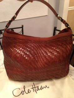 Cole Haan Genevieve Woven Leather Style Hobo Handbag Saddle Cognac Brown Tote Bag. Get one of the hottest styles of the season! The Cole Haan Genevieve Woven Leather Style Hobo Handbag Saddle Cognac Brown Tote Bag is a top 10 member favorite on Tradesy. Save on yours before they're sold out! GORGEOUS!!! SALE!!! $180!!!