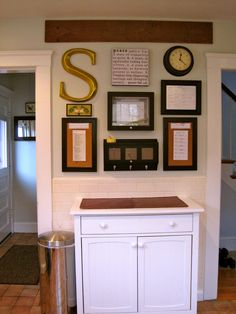 Family Command Center: Home made version of the Pottery Barn one. I like the cabinet under it too.