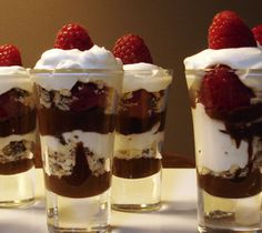 Mini Chocolate Trifles - This is Lindts decadent chocolate version of a classic English trifle. Served in shot glasses, these simple yet elegant desserts are the perfect little something to serve friends and family after dinner. Desserts In Shot Glasses, Shot Glass Desserts, Köstliche Desserts, Delicious Desserts, Dessert Recipes, Dessert Glasses, Parfait Desserts, Blueberry Desserts, Dessert Cups