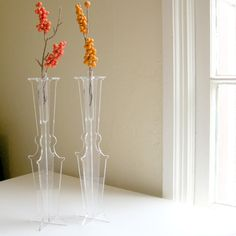 Ghost Test Tube Vases  Clear Acrylic http://www.etsy.com/listing/82279078/ghost-test-tube-vases-clear-acrylic