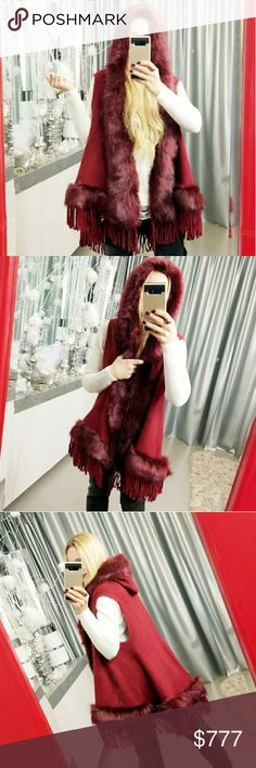 STUNNING BURGUNDY SWEATER VEST Brand new Boutique item Price is firm  Ok if you want a statement piece for the season or upcoming holidays this piece is a MUST!! Featured in a breathe taking burgundy with stunning faux fur & playful fringe detailing this hooded semi-cape vest is a masterpiece! Fabulous quality!       **Christmas winter fall holiday thanksgiving new years gift present poncho cape wrap coat jacket sweater cardigan . Sweaters Shrugs & Ponchos