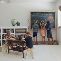 bookcase w/ kraft paper roll & chalkboard