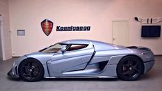 The new Koenigsegg Regera features a new robotized door system called 'Autoskin'. The system uses inbuilt hydraulics to open every door on the vehicle, inclu...