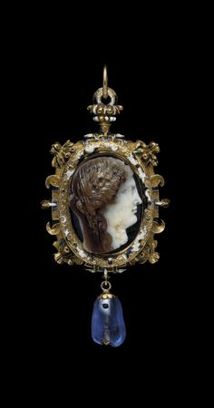 A cameo depicting a Ptolemaic Queen as Demeter, cameo: circa 200s – 100s B.C., sapphire: 11th century, mount: 16th century, gold, layered agate, sapphire, enamel, The most likely Ptolemaic princess to be represented in this portrait is Arsinoe II (c. 316-270 B.C.), daughter of Ptolemy I and Berenike. In this remarkable portrait the engraver has succeeded in presenting her as she was a woman of tremendous character, strength of will and ambition, worshipped as the Greek corn goddess, Demeter.