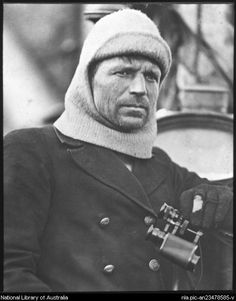 Frank Worsley, captain of the Endurance [in balaclava with binoculars, Shackleton expedition, 1914-1916 Antarctica. by Frank Hurley, Australian photographer