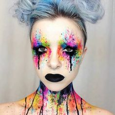 """Bout day makeup GOALS! This look would intimidate the heck out of your opponent or they'd get lost in your colorful eyes...  via Sugarpill."