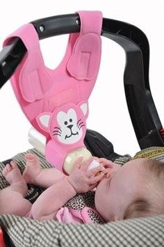 This bottle sling attaches to the car seat and offers an extra hand during bottle feedings.