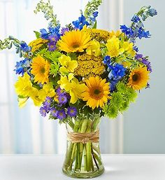 Fields of Europe™ for Summer- fresh sunflowers, delphinium, alstroemeria, yarrow, daisy poms, monte casino and variegated pittosporum $39.99- $59.99 #summer #flowers #colorfulbouquet