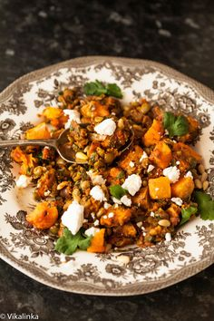 Roasted Butternut Squash with spiced lentils, feta and pine nuts. I would leave out pine nuts at our house.