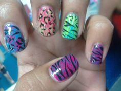 2nd day nail art  Saran wrap nails http://pinterest.com/pin/122512052333638937/  The tutorial can be found here: http://www.youtube.com/watch?v=lWvIFNkyhk4=g-all-u   ...and then I just added zebra stripes and cheetah spots with a nail art striper.