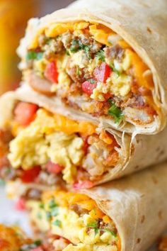 Freezer Breakfast Burritos - Meal prep over the weekend for the best burritos during the week. Loaded with tater tots, eggs, beans and cheese, of course!!