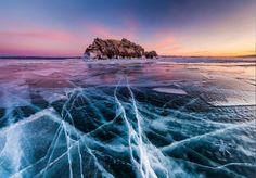 Sunset on a frozen Lake Baikal from Elenka Island in Russia. Photograph by Anton Petrus