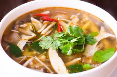 Vegetarian Mushroom Tom Yum spicy and sour soup cooked in Thai herbs lemongrass galangal and kaffir lime leaves Tom Yum Soup Vegetarian, Vegan Soups, Vegetarian Recipes, Healthy Recipes, Vegan Food, Veggie Asian Recipes, Whole Food Recipes, Soup Recipes, Cooking Recipes