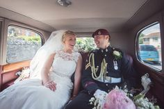 Bride and groom in Military uniform in Classic wedding car in Swanage. Photography by one thousand words wedding photographers