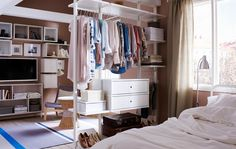 This open wardrobe also works as a boutique room divider. Great way to separate the one room for Jack and Grace.