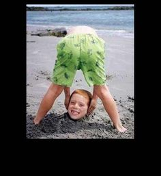 Funny photos, perfectly timed photos, boy picking head out of sand