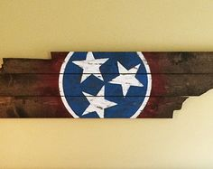 Wooden state of Tennessee cut out with state flag painted and distressed on it!
