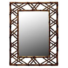 Rectangular mirror in a hand-painted openwork frame. Product:  MirrorConstruction Material: MDF, resin, metal and mirrored glassColor: Antiqued gold Features:   Hand-painted finish  Soft contemporary or casual lifestyle       Dimensions:   40.38 H x 30.9 W