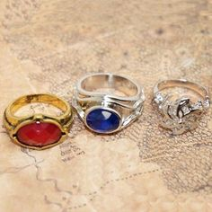 The Three Rings are magical artifacts forged by the Elves of Eregion. After the One Ring, they are the most powerful of the twenty Rings of Power. Tag a friend that would like this and remember to like and repin if you like what you see! Click here to order--> http://www.teebrewery.com/collections/lord-of-the-rings-accessories/products/three-rings-narya: