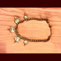 Burnished gold necklace Burnished gold necklace. Rhinestone and spikes! Jewelry Necklaces