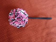 """Satin/mesh fluffy flower on a 1/4"""" black elastic band. Comes in 3 different colors.  Check out www.etsy.com/shop/beautynbows"""