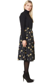 Black flared woven skirt with floral print in 100% organic certified cotton. Shell button and concealed side zip. Length 71cm.