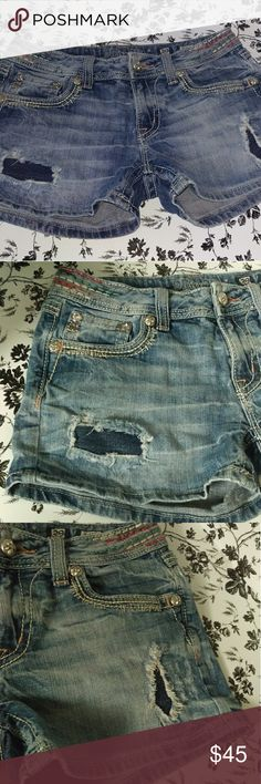 Miss Me Jean Shorts Red,White and Blue Stitching Miss Me Jean Shorts Red,White and Blue Stitching Size 29  Jean shorts distressed with Read White and Blue stitching on waist. In excellent condition. Missing 2 top buttons on patch. Miss Me Shorts
