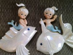 This is the cutest set of Two Norcrest Little Girl Mermaids riding on Pearl White sparkle eye Fish. They do not have their Norcrest sticker