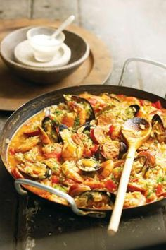 Paella Is A Traditional Rice Dish Originating In Valenica. There Is 3 Known Types. Paella Valenciana, Seafood Paella, And Paella Mixta.