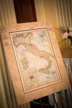 Unique wedding guestbook alternative idea - guests signed a map of Italy - the couple's honeymoon destination! {Artful Weddings by Sachs Photography}
