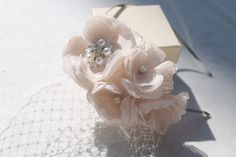 Bridal French Netting Birdcage Blusher Veil  Russian Netting Headband with Champagne Flowers Rhinestone Brooch and Pearls. $75.00, via Etsy.