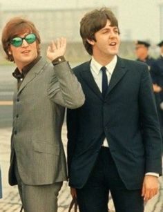 Paul McCartney around the Beatles or possibly Wings era. Don't know for sure who the guy in the sunglasses is