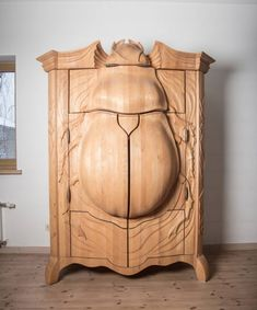This one-of-a-kind insectoid armoire is called the BUG and it was designed Latvian designer Janis Straupe of True Latvia. Full of customizable shelves, drawers, cubbies and even a few secret compartments, it's a beautifully functional piece of furniture as well as an amazing work of art.