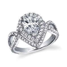 Style# SY304-PS Unique Halo Pear Shape Engagement Ring - This unique and breathtaking engagement ring features a 1.5 carat pear-shaped diamond center enhanced by a dazzling double halo of pave diamonds. The second halo of bands trails off on each side to flow gracefully down and crisscrossing to form a stunning diamond pave split shank. https://www.sylviecollection.com/unique-halo-pear-shape-engagement-ring-sy304-ps