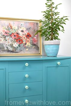Turquoise Cabinet Makeover for Budget Craft Room - From Evija with Love.  Everlong Kingfisher chalk paint, hand painted furniture, making a frame for the cabinet doors DIY