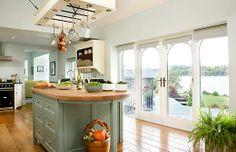 amazing kitchen...all the light, the pretty island!