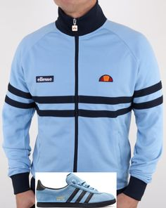 Ellesse Rimini Track Top in Sky Blue and Navy. The popular Rimini track gets a refresh. We stock more colours of the Rimini track top online. Adidas Og, Classic Outfits, Classic Clothes, Football Casuals, Tracksuit Tops, Ellesse, Blue Stripes, Adidas Jacket, Streetwear