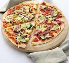 Ingredients  1 small courgette , thinly sliced  2 tsp olive oil  pinch dried oregano or picked fresh oregano leaves  1 flatbread or Mediterranean wrap  2 tbsp chilli and tomato pasta sauce  2 slices salami , cut into strips  25g emmental , grated