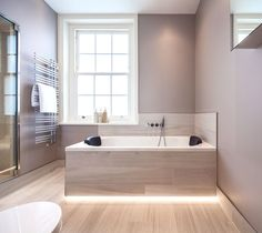Designed by Monita Cheung. Installed by Dragonfly London Limited. Photographer Nikhilesh Haval. Modern Bathroom - steam room, mother of pearl mosaics, Vola brassware, Effegibi steam door, Hayon basin and vanity top, Starck washlet WC, Bette bath with hydrotherapy jets and led lighting.
