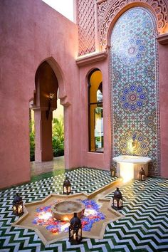 Moroccan decor for outdoor design with pink wall paint idea. Pinned by #ChiRenovation - www.chirenovation.com